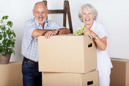 Seniors with boxes moving