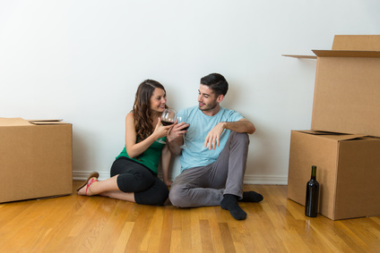 couple sitting against wall