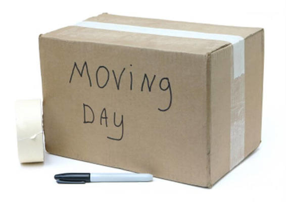 Box with Moving Day written on it