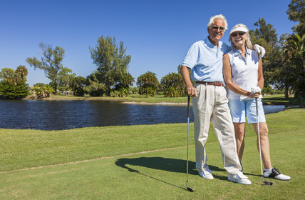 Senior Couple playing golf in adult community