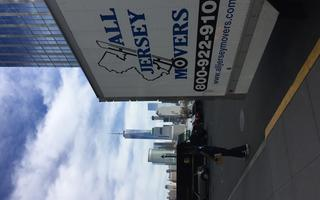Moving Truck in front of the freedom tower